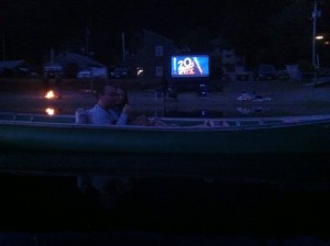 pop up screening. enjoying movie from a canoe.